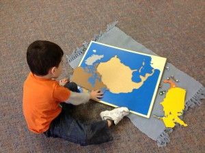 child and puzzle map